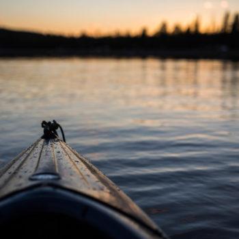 Canoe on a lake at sunset in Swedish Lapland
