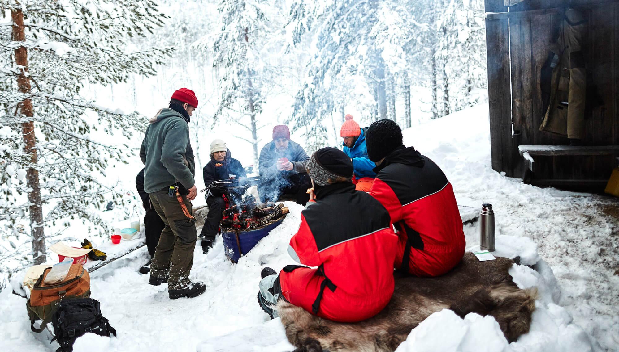 Outdoor lunch break during a dog sledding trek adventure in Swedish Lapland
