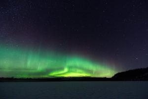 Aurores boréales sur le lac Gistrask en Laponie Suédoise